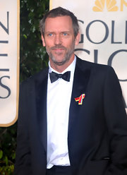 Hugh wears a classic black bow tie at the Golden Globes.