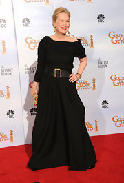 Meryl is a queen of minimalist style. Here the lovely actress dons a simple black dress with a wide leather belt.