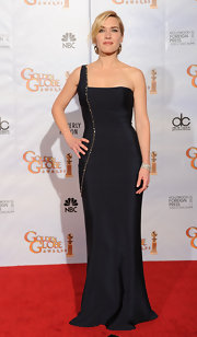 Kate loves this style of dress. Here she wears a deep blue one strap dress with a simple silhouette.