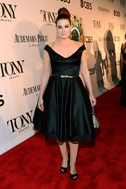 Debra Messing stuck to a fashion staple when she wore this black off-the-shoulder frock.