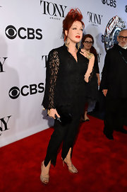 Cyndi Lauper chose a lace pantsuit for the red carpet of the 2013 Tony Awards.