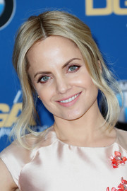 Mena Suvari styled her hair into a loose bun with face-framing tendrils for the Directors Guild of America Awards.