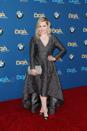 Abigail Breslin polished off her look with a metallic silver clutch.