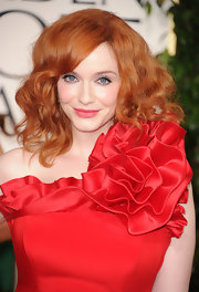 This red head knows how to amp up her locks. Loads of curls and texture completed her red carpet look.