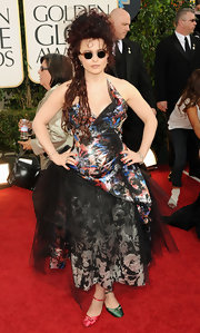 Helena Bonham Carter brought her signature daring style to the Golden Globes in a unique floral and tulle Vivienne Westwood creation.