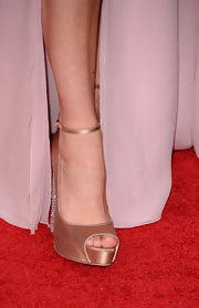 Megan Fox wore champagne satin Martina Strass platforms with jeweled heels to the 2011 Golden Globes.