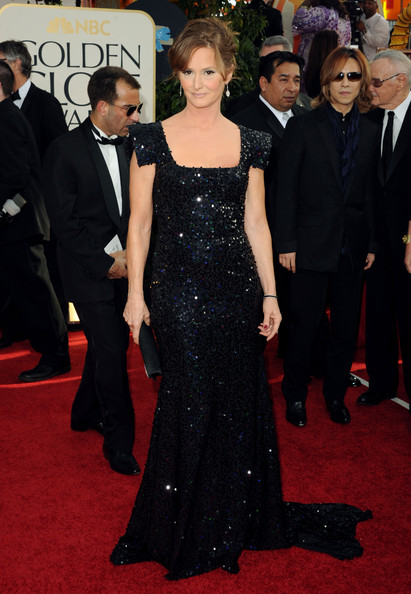 Melissa opted for a sequined evening gown with a long train and a modern sleeve design.