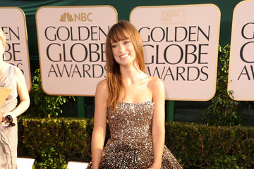 Olivia Wilde Is a Gilded Goddess in Christian Louboutin Boots at the Golden Globe Awards 2011