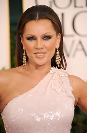 Vanessa Williams paired her one-shoulder sequined dress with ornate gold earrings.