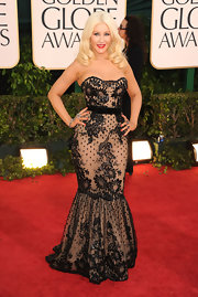 Christina was a retro diva in a strapless lace gown with a divine silhouette.