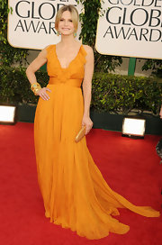 Kyra was a ray of sunshine in a chiffon evening dress with a ruffled neckline.