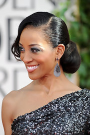 Shaun Robinson paired her sequined one-shoulder gown with a classic chignon and side swept bangs.