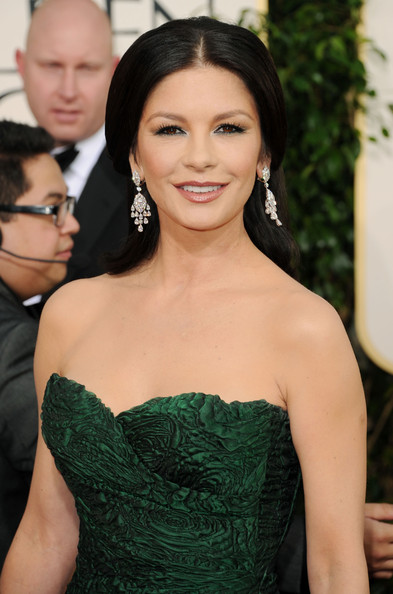 Catherine Zeta Jones opted for gorgeous diamond earrings to accent her emerald green gown.