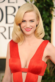 Actress January Jones put a retro spin on her sexy Versace dress at the 2011 Golden Globe Awards. The actress sported large barrel curls that were softly swept to the side.