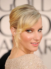 Heather Morris let her sequined dress take center stage by pinning her hair up in a simple bun. Her look was finished with curled bangs.