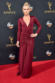 Lindsey Vonn ravished at the Emmys in a plunging wine-red gown with a ruched midsection.
