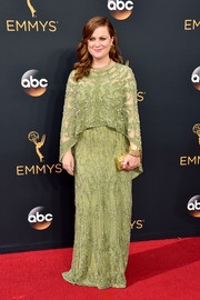 Amy Poehler was a diva in a caped and beaded green gown by Pamella Roland during the Emmys.