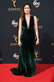 Kathryn Hahn chose an emerald-green velvet gown by Wai Ming, featuring a navel-grazing neckline and ruffle trim, for her Emmys red carpet look.