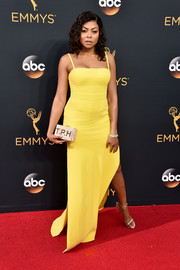 Taraji P. Henson showed off her svelte figure in a yellow spaghetti-strap column dress by Vera Wang at the Emmys.