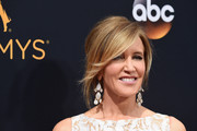 Felicity Huffman styled her hair into a loose bun for the Emmy Awards.