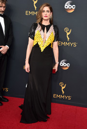 Amanda Peet attended the Emmys wearing a paillette-bodice keyhole gown by Altuzarra.