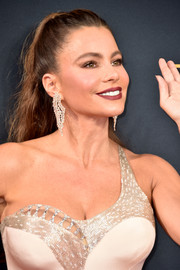 Sofia Vergara swept her hair back into a ponytail for her Emmy Awards look.