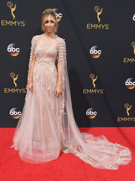 Giuliana Rancic made a grand entrance at the Emmys in a princess-worthy pale-pink Georges Chakra Couture gown, boasting a flowing cape and ruffle appliques.