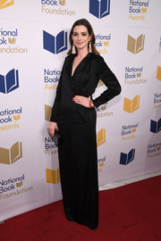 Anne Hathaway exuded understated elegance wearing this black tuxedo gown by Halston at the National Book Awards.