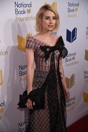 Emma Roberts paired a Victoria Beckham satin clutch with an Ulyana Sergeenko gown for her bow-themed look during the National Book Awards.