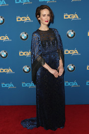 Sarah Paulson looked regal in a caped and fringed Andrew Gn gown, featuring intricate blue embroidery on a black background, during the Directors Guild of America Awards.