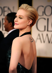 Evan Rachel Wood wore a pair of 19th century  old-mine diamond stud earrings set in black enamel and gold at the 69th Annual Golden Globe Awards.