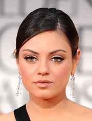 Mila Kunis paired her classic 'do with diamond chandelier earrings by Cartier.