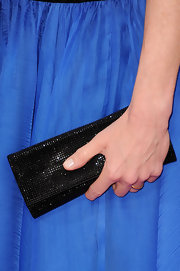 Elizabeth McGovern accessorized with a simple-yet-elegant beaded black clutch at the Golden Globe Awards.