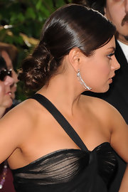 Mila Kunis attended the 69th Annual Golden Globe Awards wearing her hair in a pretty mass of pinned-up curls.