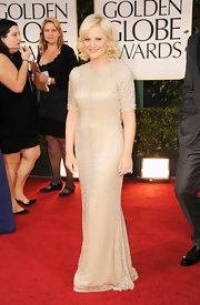 Amy Poehler went for a neutral look at the Golden Globes with this glimmering ivory dress.