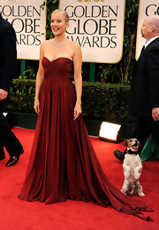 Penelope Ann Miller may have looked divine in a red gown, but it looked like Uggie was stealing the spotlight on the Golden Globe red carpet.