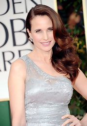 Andie MacDowell wore a pair of 23-carat marquise-cut multicolor cluster earrings set in white gold at the 69th Annual Golden Globe Awards