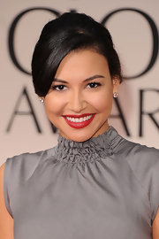 Naya Rivera wore a rich ruby red pop of lipstick at the 69th Annual Golden Globe Awards.