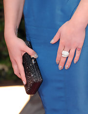 Kelly Osbourne wore an iridescent glitter nail polish at the 69th Annual Golden Globe Awards.