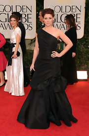Debra Messing wore a one-shoulder black taffeta gown to the Golden Globe Awards.