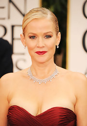 Penelope Ann Miller wore a 50-carat diamond bib necklace and 6-carat pear-shaped diamond drop earrings at the 69th Annual Golden Globe Awards.