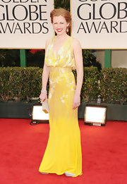 Mireille Enos wore this bright yellow gown with shining silver beads for the Golden Globes.
