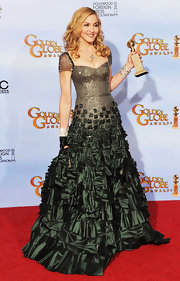 Madonna took home a Golden Globe for her latest movie in a sparkling gown with an embellished skirt.