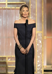 Michelle Pfeiffer dressed up her simple gown with a trio of gold bracelets when she attended the Golden Globes.