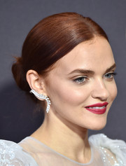 Madeline Brewer went classic with this center-parted bun at the 2017 Emmys.