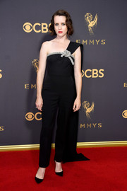Claire Foy looked effortlessly elegant at the 2017 Emmys in a black Oscar de la Renta jumpsuit with crystal knot detailing.