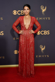 Gina Rodriguez showed her sultry side in a beaded red Naeem Khan gown with a dangerously low neckline during the 2017 Emmys.