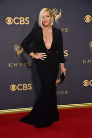 Jane Krakowski brought major sex appeal to the Emmys red carpet with this plunging, curve-hugging black gown by Badgley Mischka.