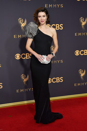 Mary Elizabeth Winstead attended the 2017 Emmys wearing a black Armani Privé one-shoulder gown with a striped puffed sleeve.