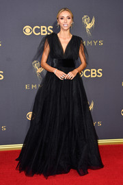 Giuliana Rancic went goth-glam in a black empire gown by Monsoori at the 2017 Emmys.